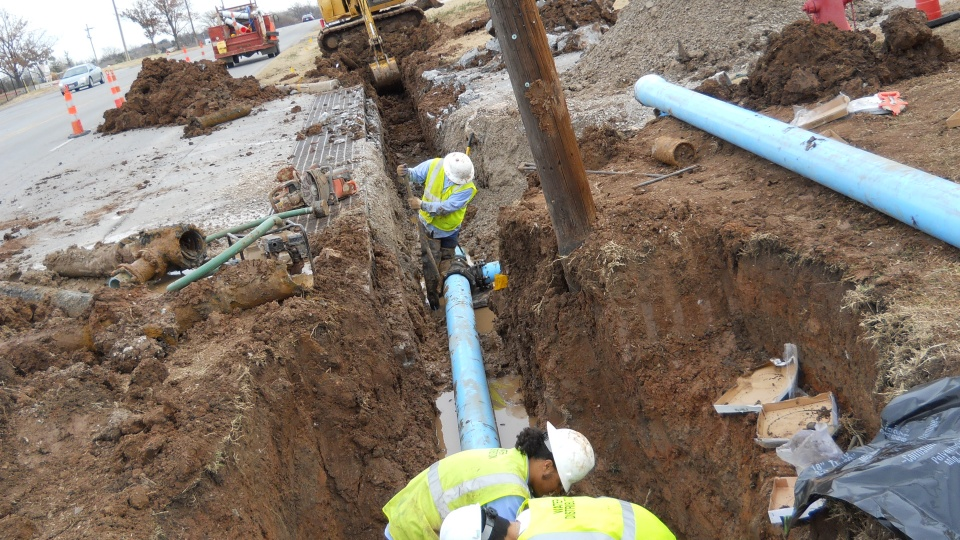 Water Distribution Employees installing a water main line