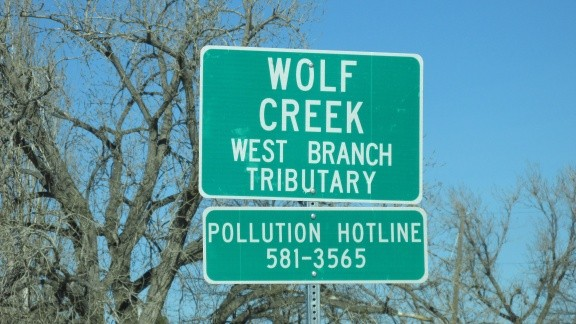 Wolf Creek sign at 67th st