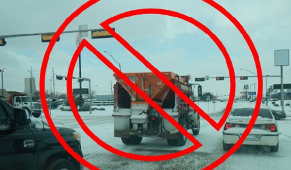 Pull alongside equipment at a controlled intersection, always allow 200 feet of clearance