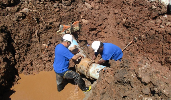 Water Distribution Employees repairing a water main line